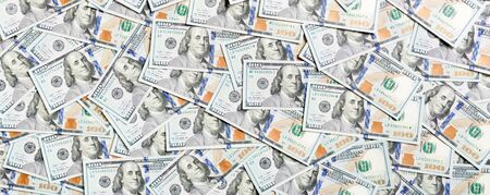 Top view of American money background. Pile of dollar cash. Paper banknotes concept. Фото со стока