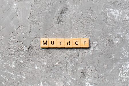 murder word written on wood block. murder text on table, concept. Stock Photo