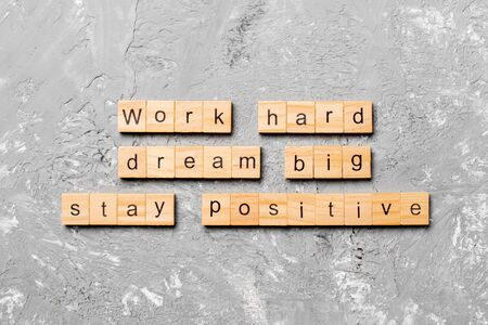 Work hard dream big stay positive word written on wood block. Work hard dream big stay positive text on cement table for your desing, Top view concept. 写真素材