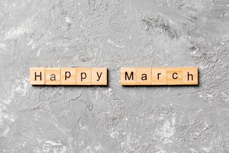 Happy March word written on wood block. Happy March text on table, concept.
