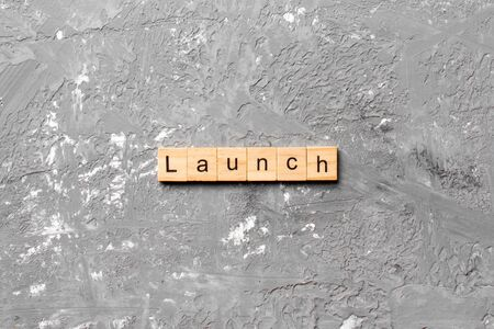 launch word written on wood block. launch text on table, concept.