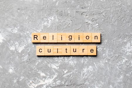 Religion Culture word written on wood block. Religion Culture text on cement table for your design, concept. Stok Fotoğraf