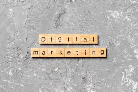 Digital Marketing word written on wood block. Digital Marketing text on cement table for your desing, concept.