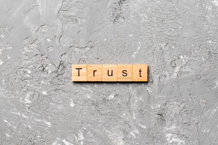 TRUST word written on wood block. TRUST text on table, concept. Stok Fotoğraf