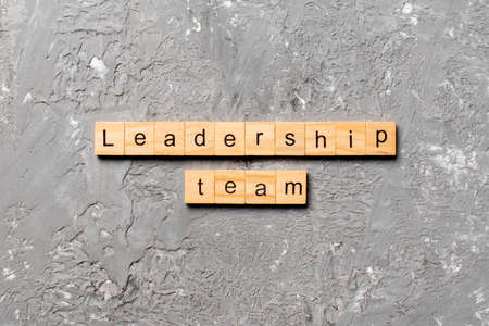 leadership team word written on wood block. leadership team text on cement table for your desing, concept.