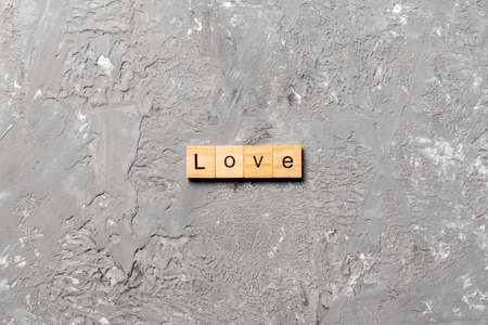 love word written on wood block. love text on table, concept. Archivio Fotografico