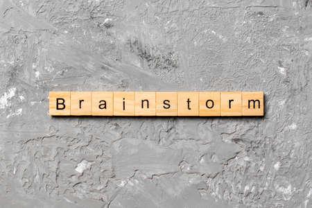 brainstorm word written on wood block. brainstorm text on table, concept. 版權商用圖片