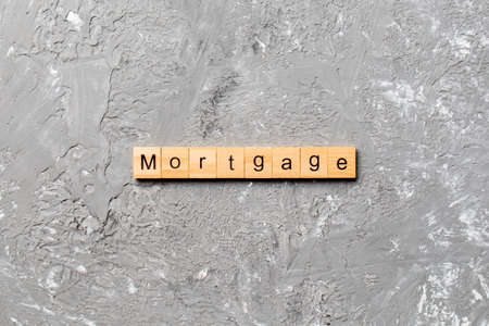 MORTGAGE word written on wood block. MORTGAGE text on cement table for your desing, concept. Reklamní fotografie