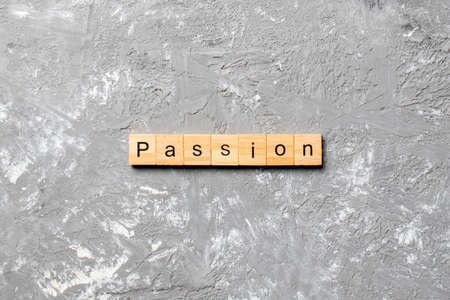 passion word written on wood block. passion text on table, concept.