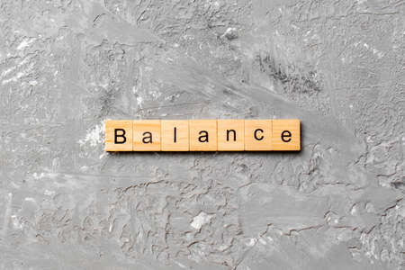 balance word written on wood block. balance text on cement table for your desing, concept. 스톡 콘텐츠