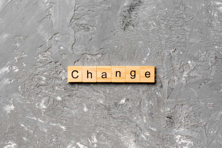 CHANGE word written on wood block. CHANGE text on cement table for your desing, concept.