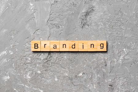 branding word written on wood block. branding text on table, concept.