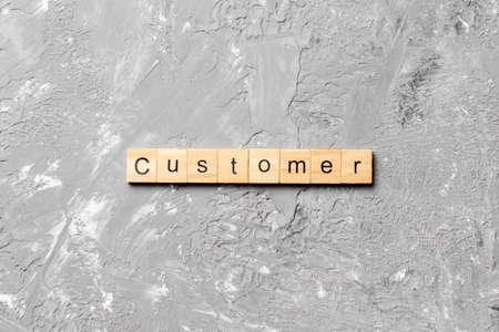 customer word written on wood block. customer text on table, concept. 스톡 콘텐츠