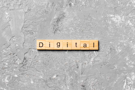 DIGITAL word written on wood block. DIGITAL text on cement table for your desing, concept.