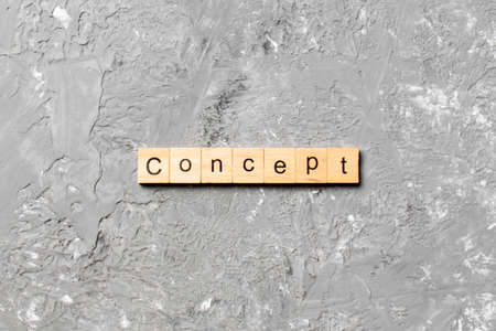 Concept word written on wood block. Concept text on table, concept. 스톡 콘텐츠