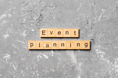 Event planning word written on wood block. Event planning text on table, concept.