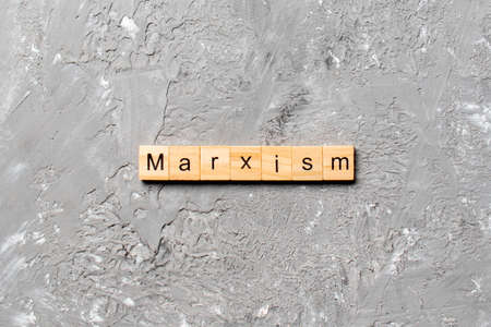 marxism word written on wood block. marxism text on table, concept. 스톡 콘텐츠