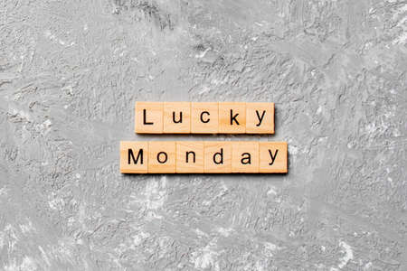 lucky monday word written on wood block. lucky monday text on cement table for your desing, concept.