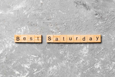 best saturday word written on wood block. best saturday text on cement table for your desing, concept. 스톡 콘텐츠