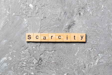 scarcity word written on wood block. scarcity text on cement table for your desing, concept.