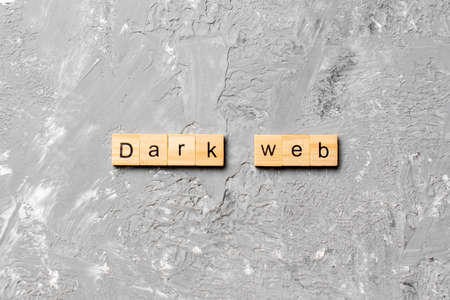 Dark web word written on wood block. Dark web text on cement table for your desing, concept.