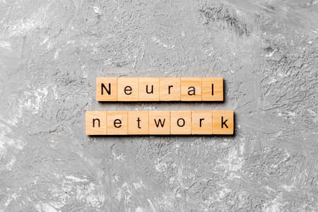 NEURAL NETWORK word written on wood block. NEURAL NETWORK text on cement table for your desing, concept.
