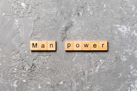 Man Power word written on wood block. Man Power text on cement table for your desing, concept. Stock Photo