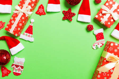Top view of Christmas decorations on green background. New Year holiday concept with copy space.