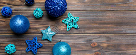 Top view Banner of festive winter composition on wooden background with empty space for your design. Christmas baubles and decorations. New Year concept.