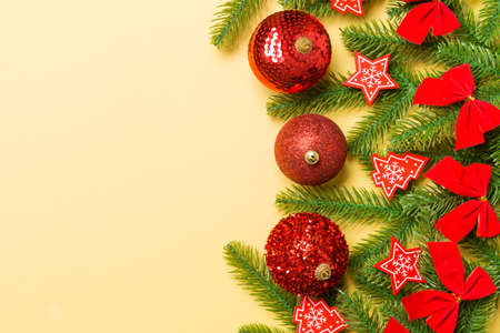 Set of festive balls, fir tree and Christmas decorations on colorful background. Top view of New Year ornament concept with copy space. 免版税图像