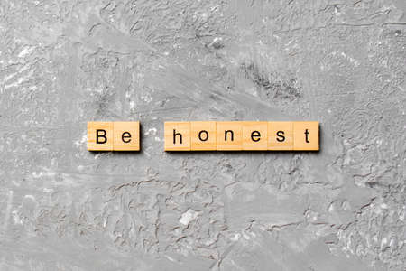 be honest word written on wood block. be honest text on table, concept.