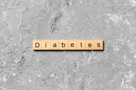 diabetes word written on wood block. diabetes text on table, concept. 免版税图像