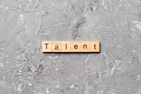 Talent word written on wood block. Talent text on cement table for your desing, concept.