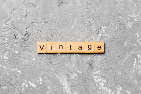vintage word written on wood block. vintage text on cement table for your desing, concept.