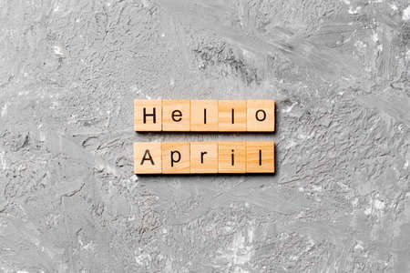 hello april word written on wood block. hello april text on table, concept.
