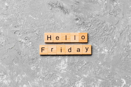hello friday word written on wood block. hello friday text on cement table for your desing, concept.