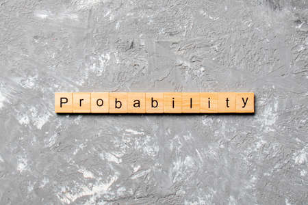 probability word written on wood block. probability text on table, concept.