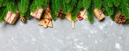 Top view Banner of Christmas background made of fir tree and decorations on cement background. New year holiday concept with copy space.