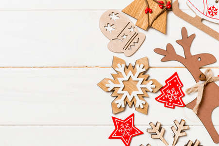 Top view of Christmas decorations and toys on wooden background. Copy space. Empty place for your design. New Year concept. 版權商用圖片