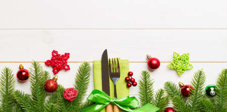 Top view Banner of festive cutlery on new year wooden background. Christmas decorations with empty space for your design. Holiday dinner concept.