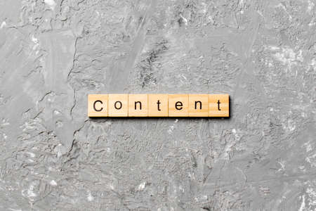 Content word written on wood block. Content text on cement table for your desing, concept. 版權商用圖片