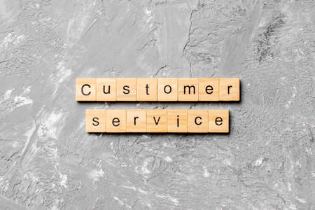 customer service word written on wood block. customer service text on cement table for your desing, concept.