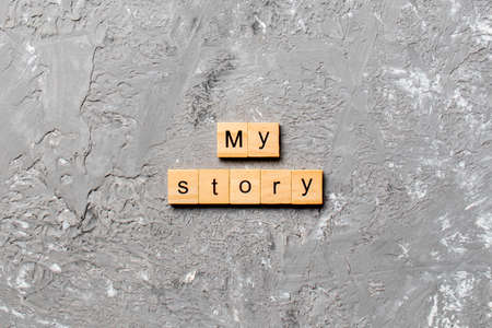 My story word written on wood block. My story text on cement table for your desing, concept.