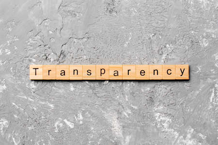transparency word written on wood block. transparency text on table, concept. 版權商用圖片