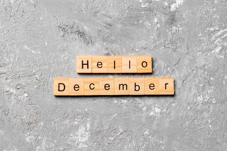 hello december word written on wood block. hello december text on table, concept.