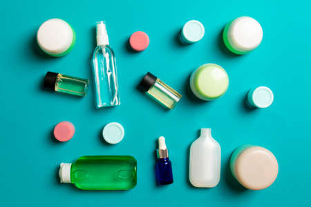 Group of plastic bodycare bottle Flat lay composition with cosmetic products on colored background empty space for you design. Set of White Cosmetic containers, top view with copy space. 版權商用圖片