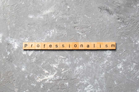 Professionalism word written on wood block. Professionalism text on cement table for your design, concept. Zdjęcie Seryjne