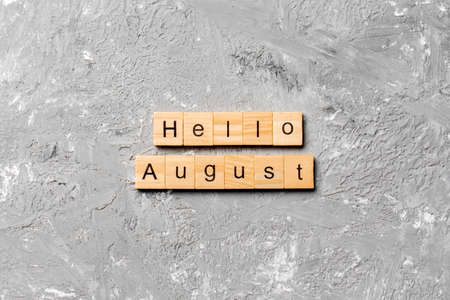 hello august word written on wood block. hello august text on table, concept.