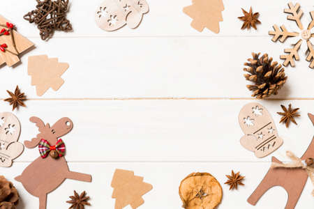 Top view of Christmas decorations and toys on wooden background. Copy space. Empty place for your design. New Year concept. Stok Fotoğraf