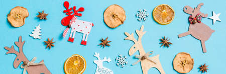 Top view Banner of holiday decorations and toys on blue background. Christmas ornament concept. Stok Fotoğraf